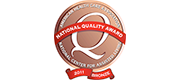 Logo for the National Quality Award – Bronze Commitment to Quality. Timberhill Place received the award in 2012.
